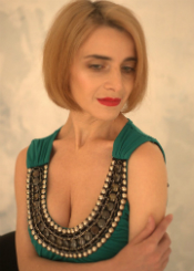 Olga from Rivne, Ukraine. Active and romantic single